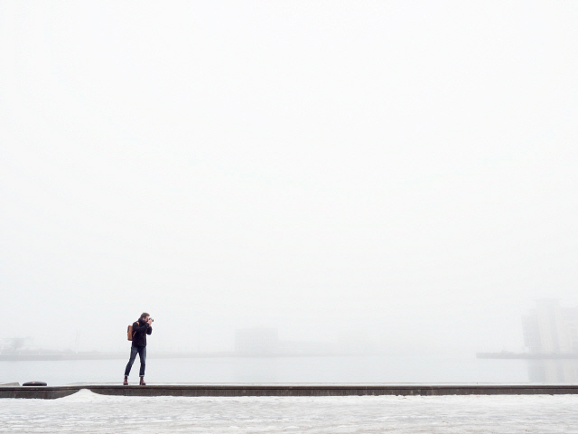 Sweden Skane Malmo Man taking photo on pier