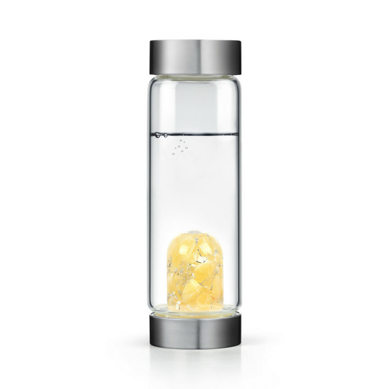 VITAJUWEL GEM-WATER BOTTLE - The line is engineered to enhance everyday tap or filtered water using the energy of gemstones encased in elegant glass vessels, boosting the pH and oxygen levels of everyday drinking water. In the natural healing arts, this blend of orange calcite and clear quartz is also said to help balance your sexual energy and is great for your hair, skin and nails.To purchase: LONDON JEWELERS (2 Main Street, East Hampton, NY)