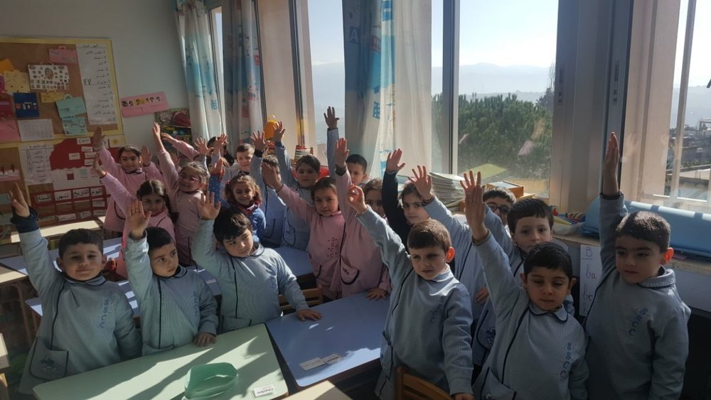 Children in classroom near the newly installed windows