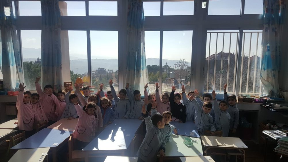 EOL 2018 - B0867 children in class with the newly installed windows.jpg