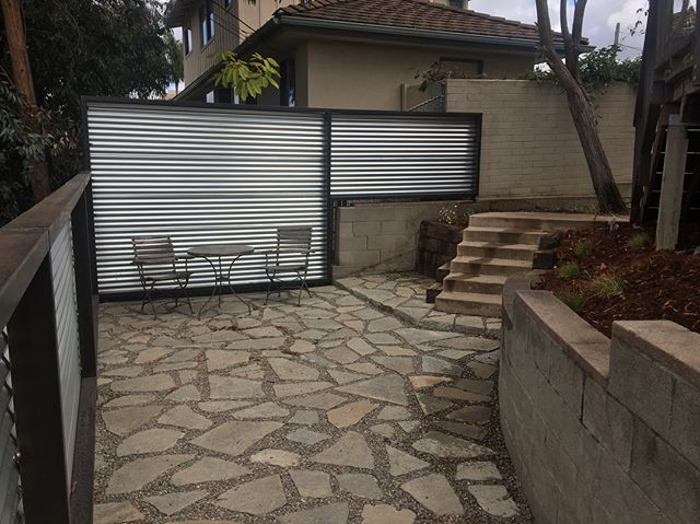 From CRAY to YAY! SHAM TO GLAM. Scroll for the dirt behind this install.  Custom everything: urbanite patio, welded steel fence with patina, railroad tie stairs, Catalina Cherry hedge with a Catalina view. 😎