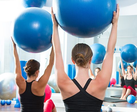 Pilates Mat classes are based off the principles of Joseph Pilates.  We incorporate the lengthening of muscle into the strength of movement, to create a strong, lean core and muscle tone throughout the body.  We incorporate the use of props, such as small weights, BOSUs, and physio balls to create a workout that is both effective and safe.  Due to the awareness of spinal musculature, posture and joint stability, this class will transform your posture and balance, as well as your overall feeling of a strong lean body.  All levels are welcome.  Private training is available. -