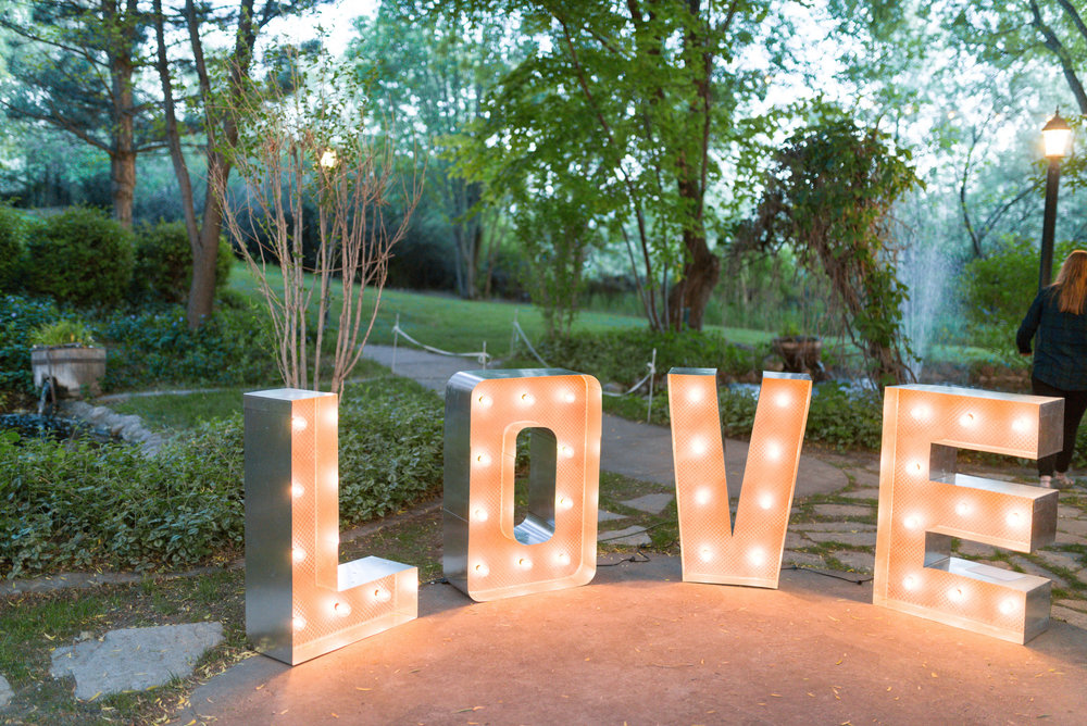 $100.00 These hand made marquee LOVE letters are made with real wood and aluminum with large Globe lights. They stand 3 feet tall. These stand on their own and can be plugged into each other. These are a beautiful statement piece that will be great photo opportunities for your wedding.