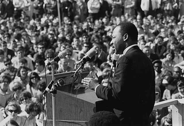 Martin Luther King, Jr. speaking to a crowd.