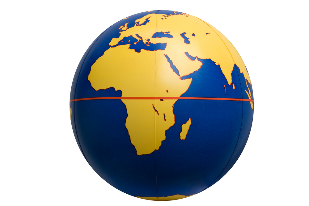 The red line on the globe shows the equator. The equator gets the most sunlight and is the warmest place on Earth.