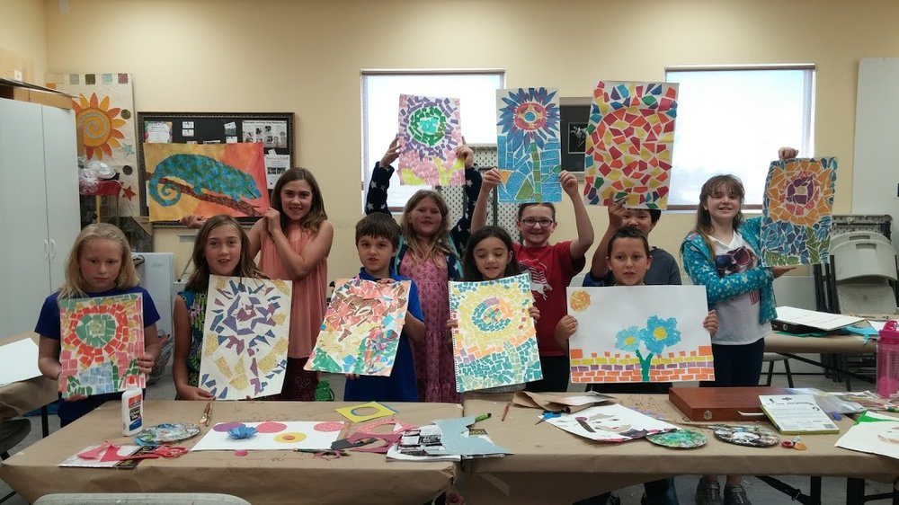 One of my collage classes at Blaine's Art Supply shows off their paper mosaic projects.
