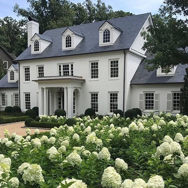 This stunning white home, designed by @robertdnorris and featured in @betterhomesandgardens is the perfect push we need on the Wednesday grind. #goals