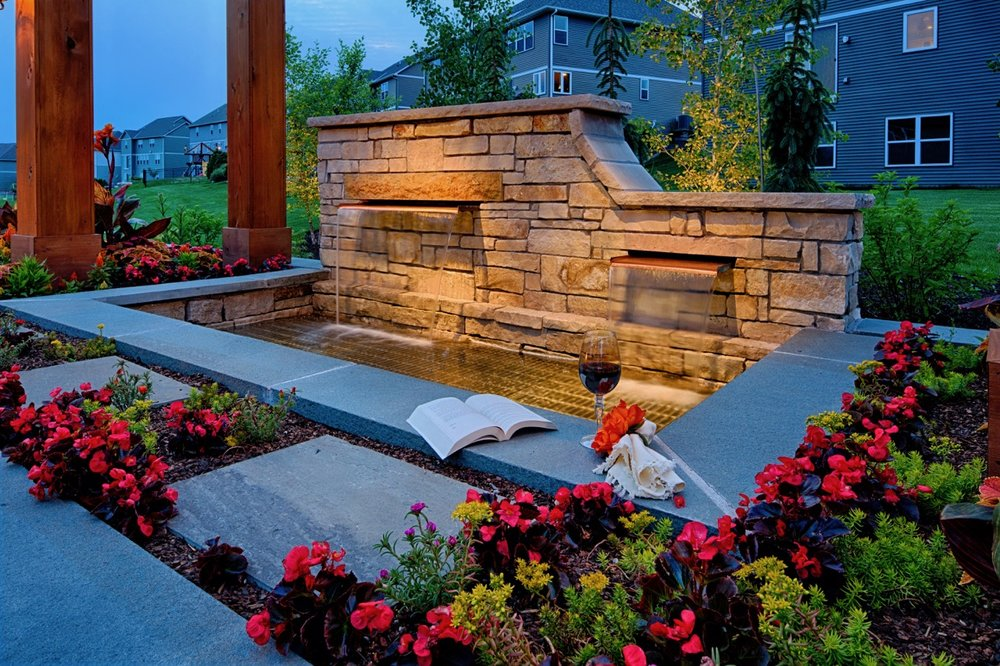 Moms Design Build - Natural Stone Water Feature Plant Flowers installation
