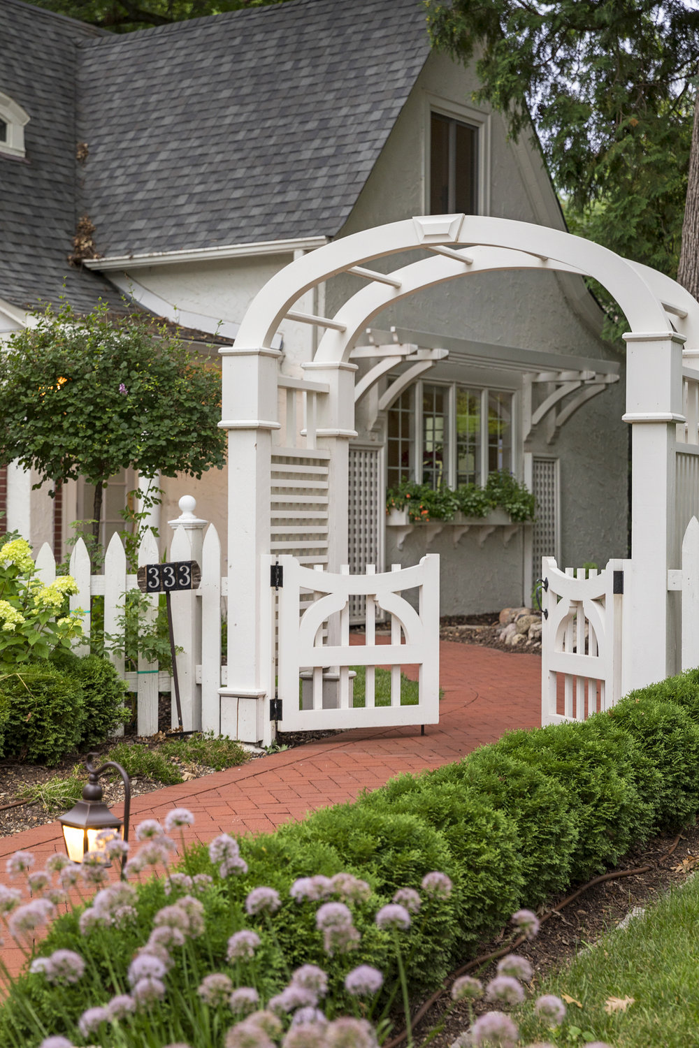 Mom's Design Build - White Fence Archway Pergola