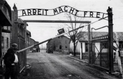 """Arbeit macht frei"" (work sets you free) sign at the Auschwitz Nazi death camp in Poland"