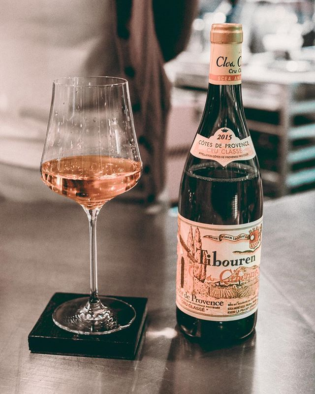 "Why was this Somm Alexandra Minton's Rosé pick of the summer? 1. ""It's French, yet it boldly advertises the name of the grape (Tibouren) on the label (which is virtually unheard of in the French wine culture - you're just supposed know that red Burgundy is Pinot Noir, white Burgundy is Chardonnay, etc.) No pretension at Clos Cibonne, though. The AOC (France's wine-governing agency) granted Clos Cibonne special permission to list the grape varietal on the label due to its super-limited growth anywhere but at the estate of Clos Cibonne."" 2. ""This Rosé is even more special because, after fermentation, the wine is aged for an entire year under fleurette (yeast), giving it a bit more depth and ummmppphhh 👊🏻 than other traditional Provençal rosés."" #firstdayoffall #ripsummer #noladrinks #sommlife"