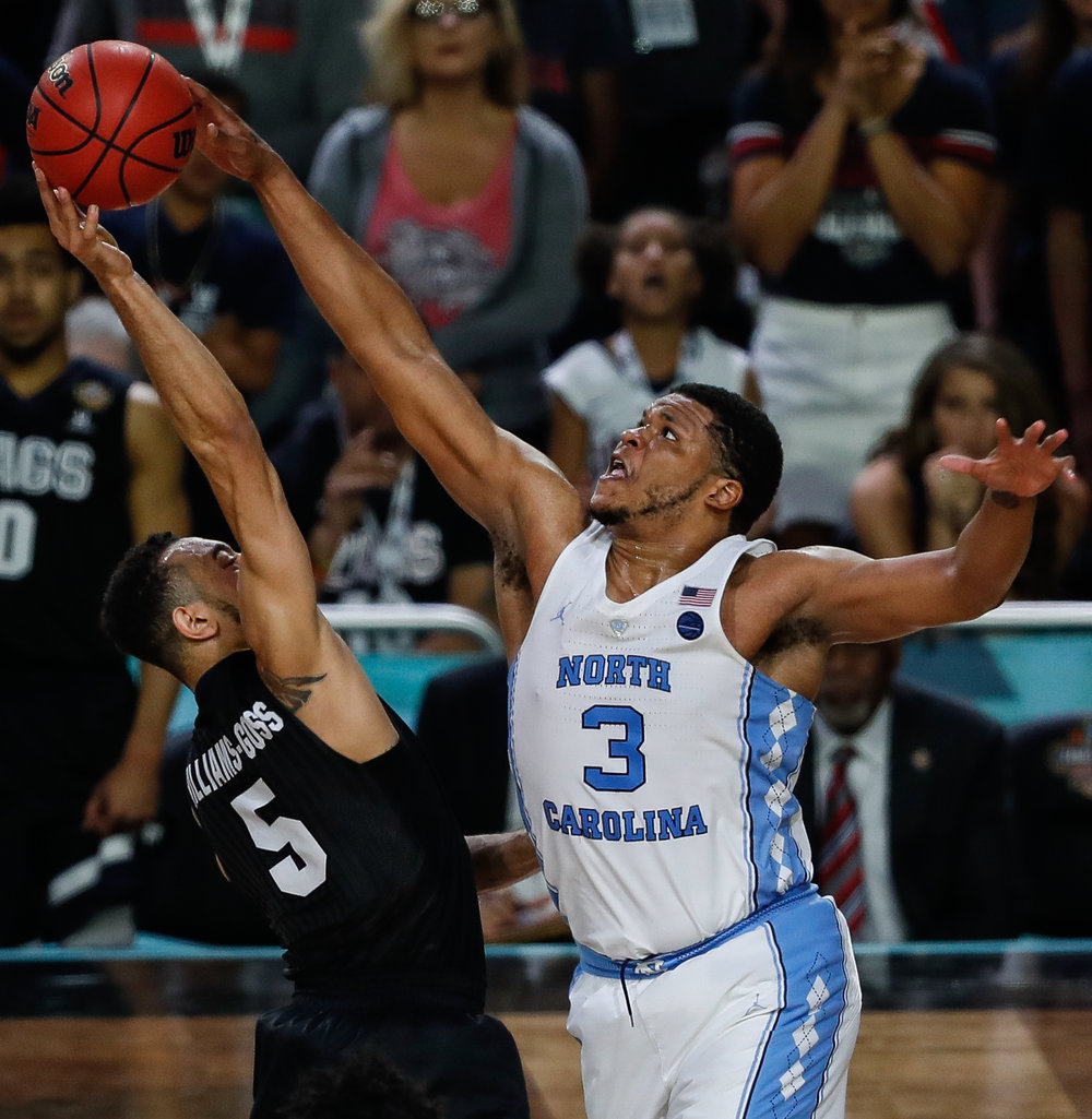 North Carolina forward Kennedy Meeks (3) blocks Nigel Williams-Goss (5) in the dying moments of the NCAA Final against Gonzaga on April 3, 2017. The Tar Heels won 71-65.
