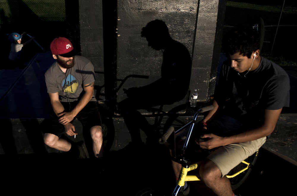 Thomas Andres (left) and Bryant Morales (right) take a break from doing BMX tricks at Wasena Park in Roanoke, Va. on June 4, 2018. Both have been regulars at the skate park for years.