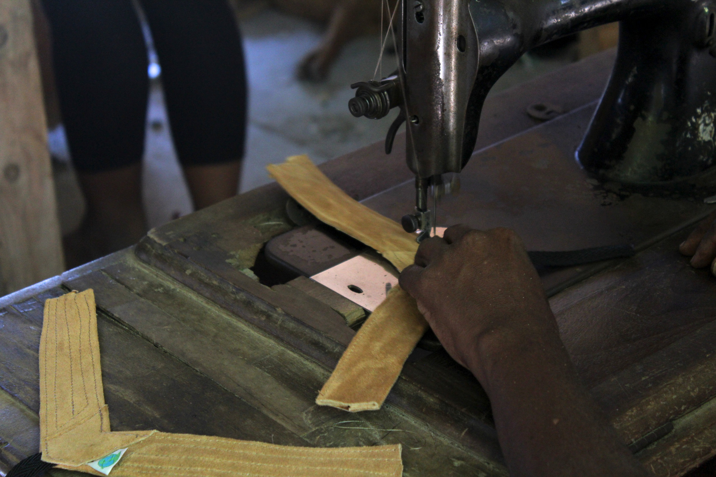 The reclaimed leather foot straps are being sewn and reinforced. Photo: A Bergamin