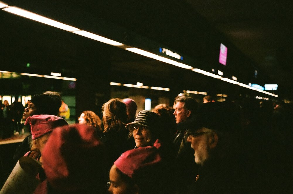 A moment of connection in the rushing throng.  (40mm, Portra 400)