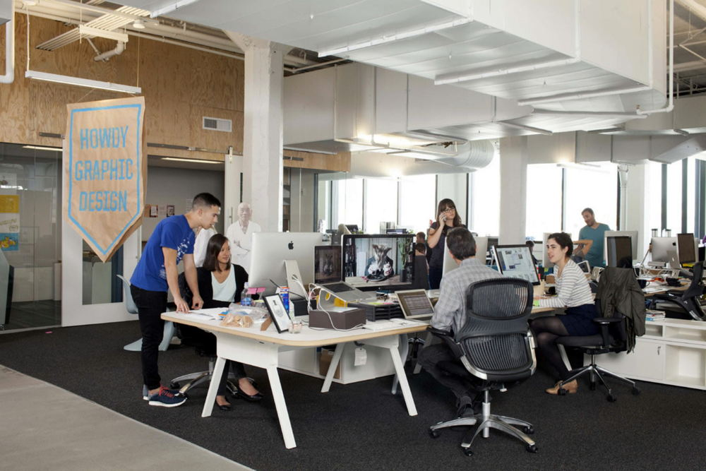 a typical open plan office with most co-workers sitting