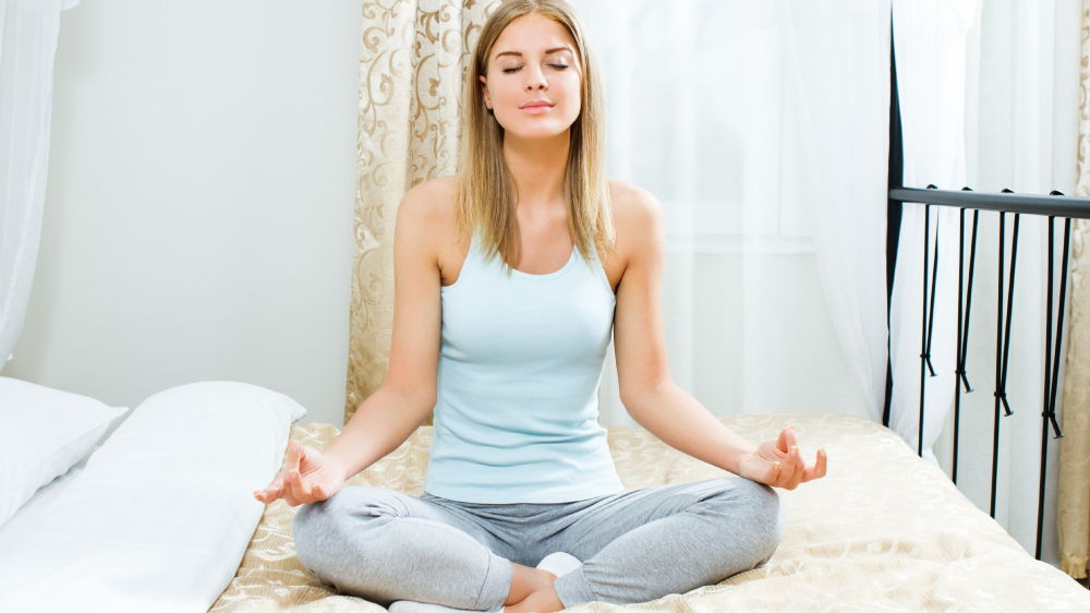 yoga in bed - find your center and relax with some breathing exercises