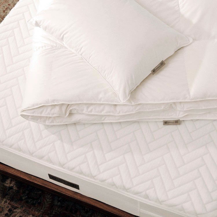 Wright Bedding also offers exclusive linen duvet covers and shams designed by Brooklyn based artist and textile designer Caroline Z Hurley and duck down pillows and comforters.