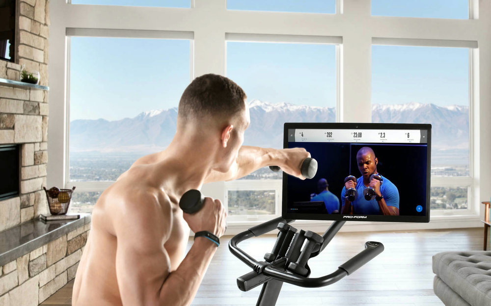 The ProForm comes with iFit Coach that provides live cross fit classes and the live spin classes incorporate upper body building exercises with the two three pound dumbbells that are included