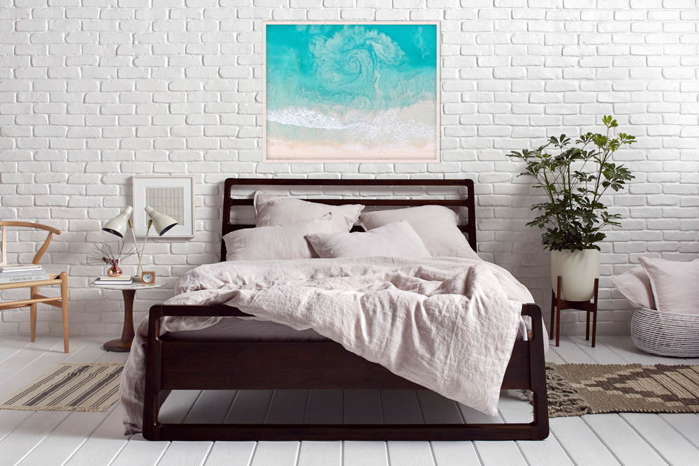 You receive a $100 to spend on Parachute Home when you purchase a  Bedaga mattress .  See how a Gray Malin photo compliments the styling.  Shown with Blush linen sheets and duvet from  Parachute Home.