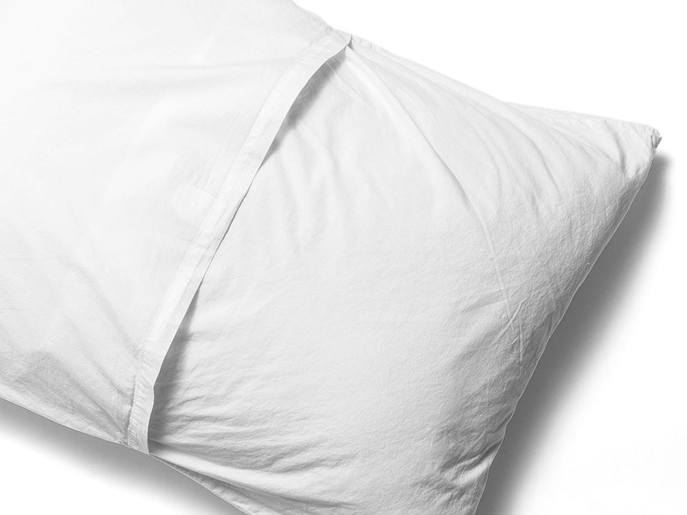 THE PILLOW CASES HAVE A DESIGNER FEATURE OF AN ENVELOPE CLOSURE ON THE BACK SO IT KEEPS A SLEEK AND A FINISHED LOOK ON THE BED.
