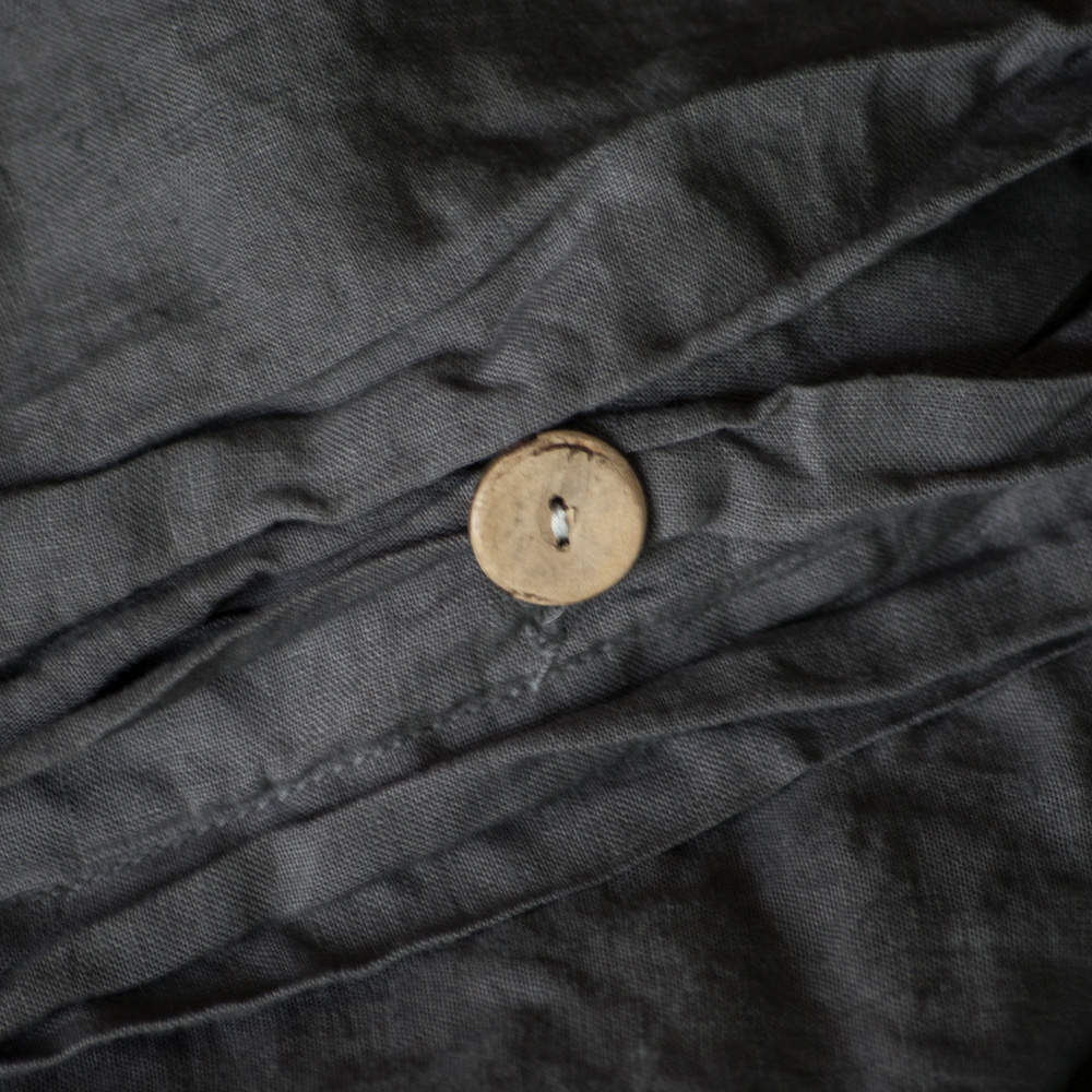 THE DUVET COVER  HAS LOOPS INSIDE AT EACH CORNER AND CLOSES WITH BUTTONS