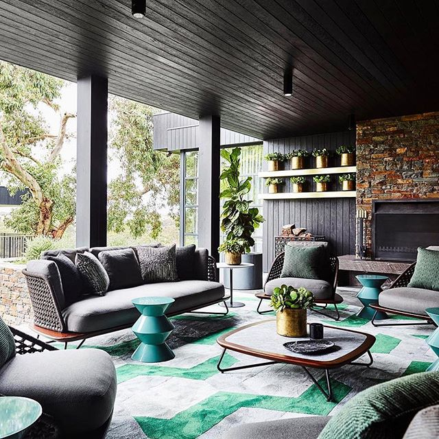 Talk about an extension of your living space outdoors! Yowza! If we had this outdoor living room, we'd never go back inside! Thanks @bellemagazineau for sharing this stunning design from  @gregnatale. Photo by @smartanson. #thatfireplacetho #naturelovers #dallashomebuilder