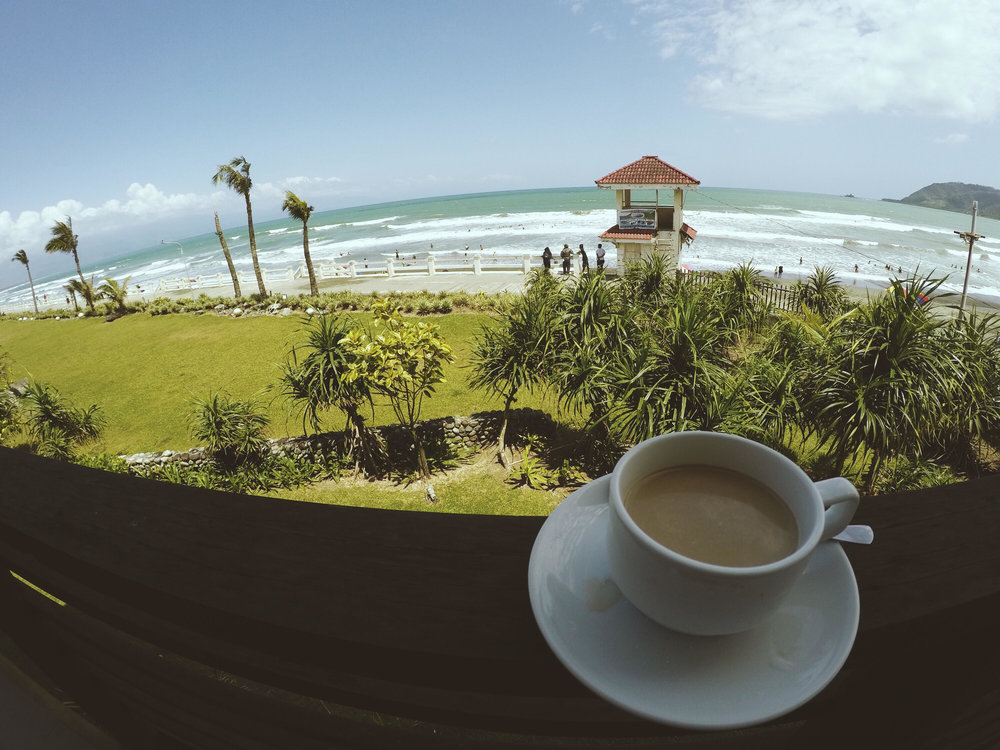 We stayed at  Costa Pacifica . Here's me having a cup of brewed coffee by the beach.