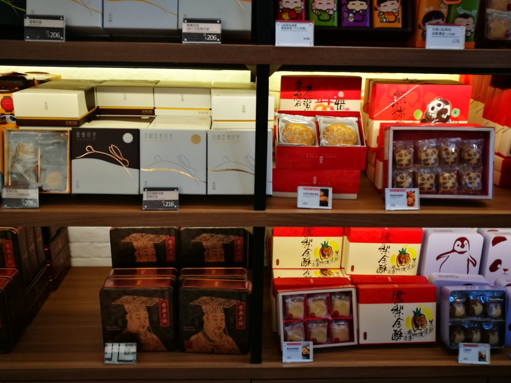 Mooncakes with assorted fillings placed in boxes ready for distribution