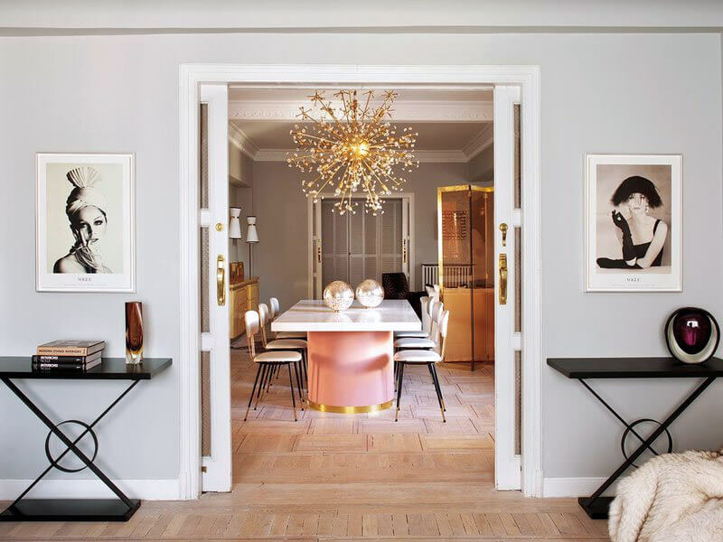 Living-Pink-Madrid-apt-vintage-femme-elegance-glam-dining-room-sliding-doors-Vintage-Vogue-photographs-pink-brass-table-brass-flower-chandlier.jpg