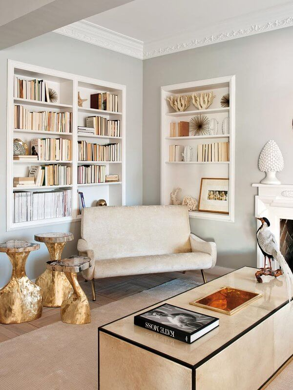 Living-Pink-Madrid-apt-vintage-femme-elegance-glam-living-room-built-in-bookcases-Jon-Urgoiti-gold-tables.jpg