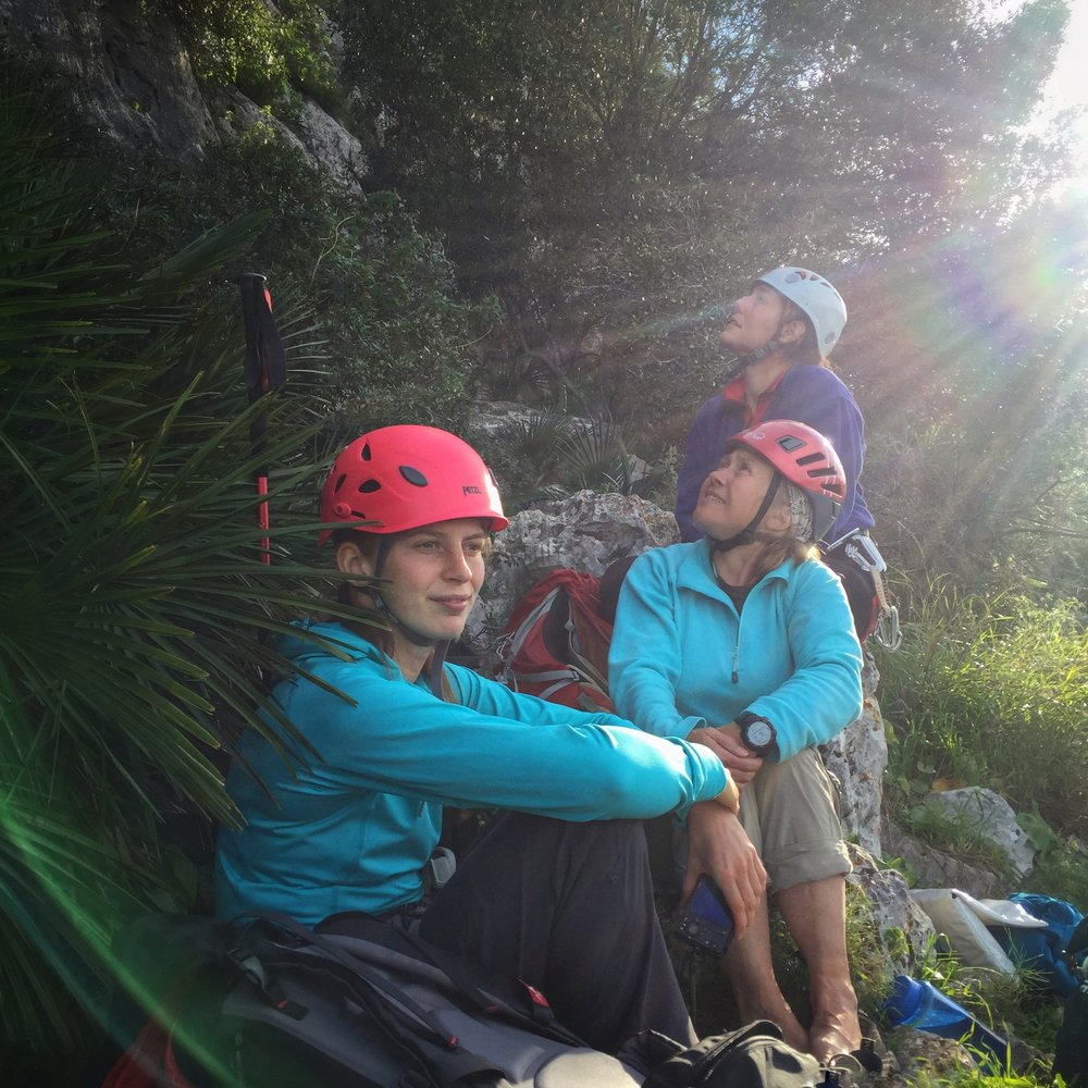 Kim Jackson (centre) planning which routes to climb next at sport climbing crag L'Ocaive, Costa Blanca