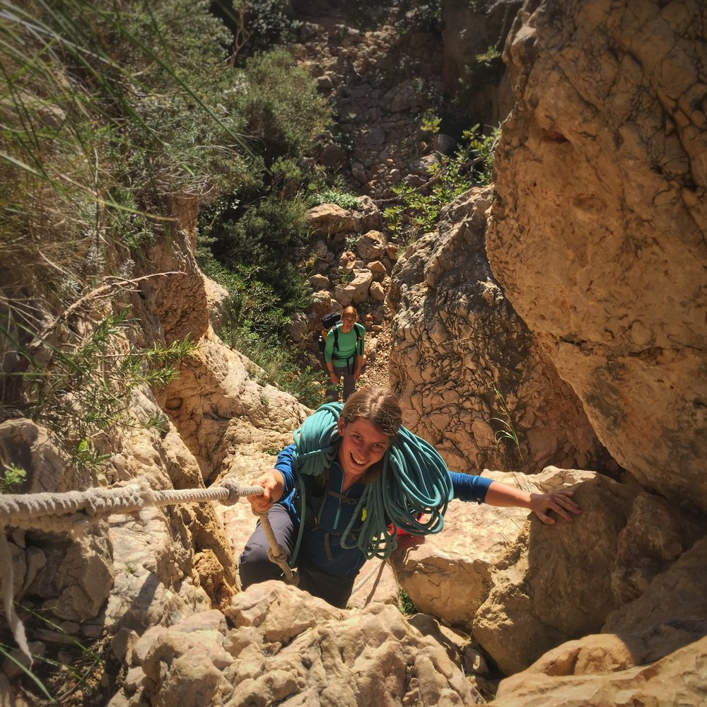 Kate Ayres (top) leading the way through a 'hidden' canyon approach route, Costa Blanca
