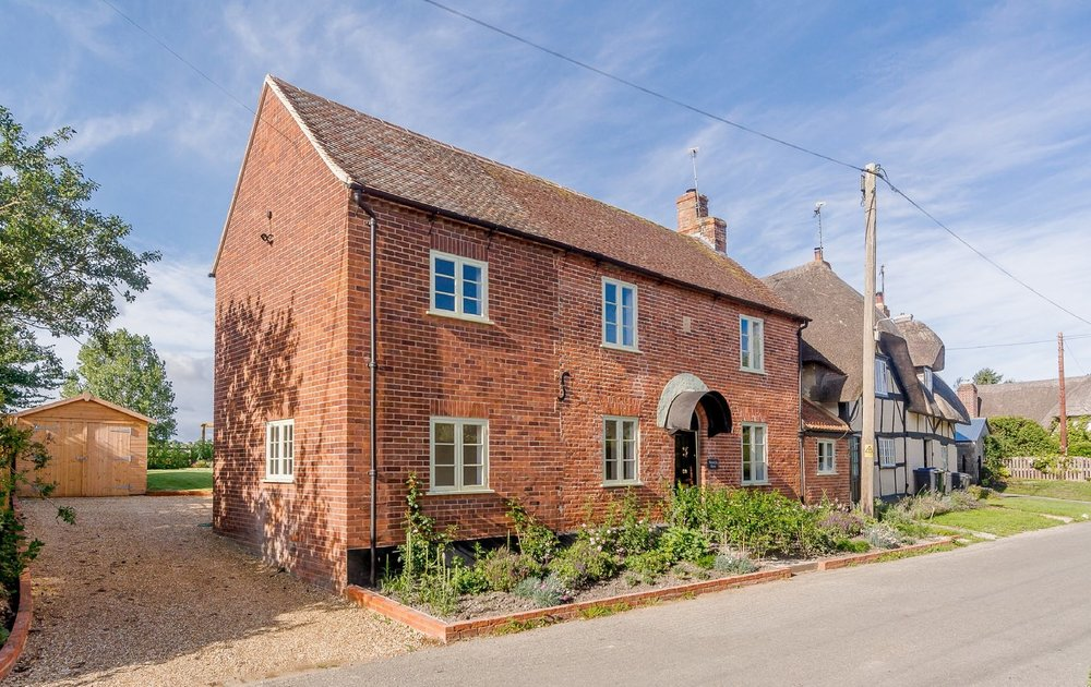 This was a listed building now completely refurbished-Listed building  New windows,heating,electrics  New rear extension  New timber garage  New landscaping  Photographs below show property prior to total refurbishment