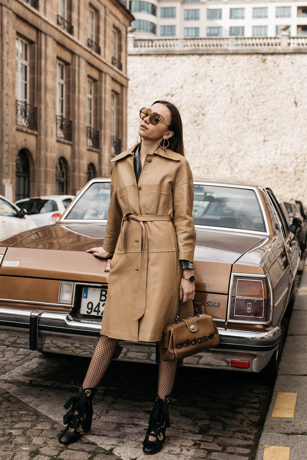 70s-vintage-car-style-editorial-fishnet-tights-miista-lace-up-boots-thefashioncuisine-7.jpg