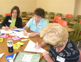 Reba Turk, center, working with AMSTI staff to design engaging science activities.