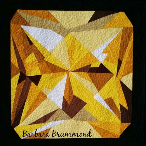 Citrine birthstone made from commercially available prints and used as a pillow top. Maker: Barbara Brummond of threads run thru it quilt shop (Rustburg, virginia)