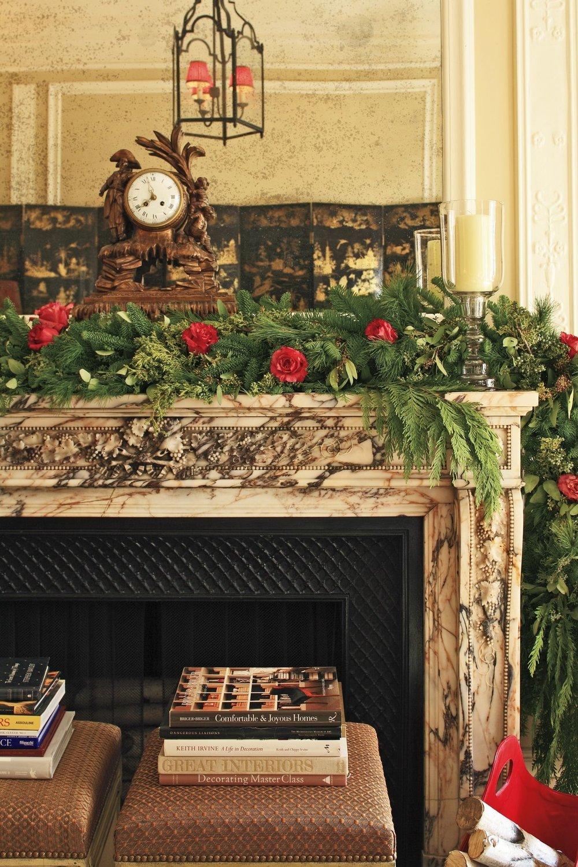 1478284436-holiday-decorations-garland-fireplace.jpg