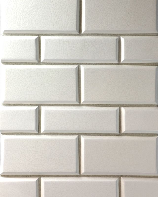 Crackle variation between each tile -- No two pieces are ever the same 🤯 -- Featuring our 3x6 and 2x6 Beveled Tile in Ice Cream Crackle  #handmadetile #handpaintedtile #handcarved #ceramictile #designlovers #tile #color #stylegram #interior123 #tiletuesday #interiordesign #roominspo #backsplash #walltile #tileart #dreamkitchen #design #tileconcepts #kitchendesign #bathroomdesign