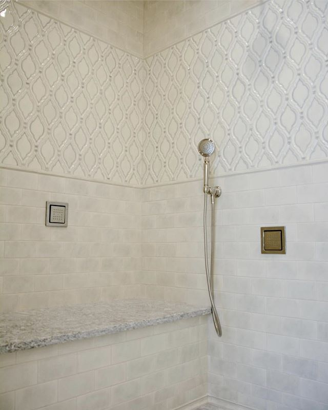"""Repost: @blueprint_dreams """"These Quemere tiles are gorgeous!! I used 3X6 Manhattan field tile, Valencia deco tile, Square Pencil Liner Border, and Brittany Baseboard at the floor and ceiling. The color is Old World Crackle Charcoal Grey. #blueprintdreams #quemeredesigns #kohler #interiordesign #masterbathroom #shower #designinspiration #luxury #handmade #americanmade #ceramictiles"""" . . . We are excited to share this gorgeous shower installation with you! Stay tuned for more 💜"""