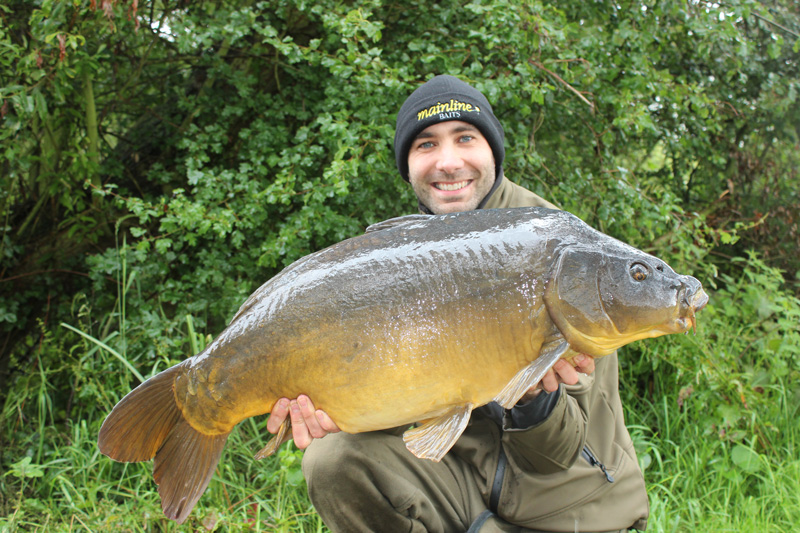 A chunky mirror, caught in the latter months of the year, on a very quiet water.