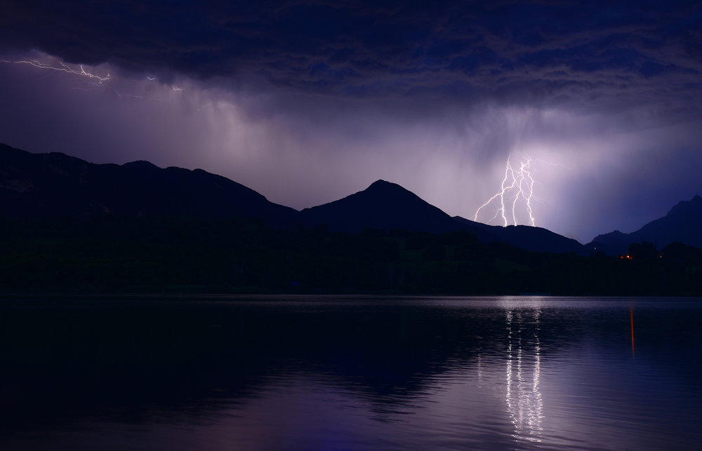 A night shot of lightning bolts over the alps.