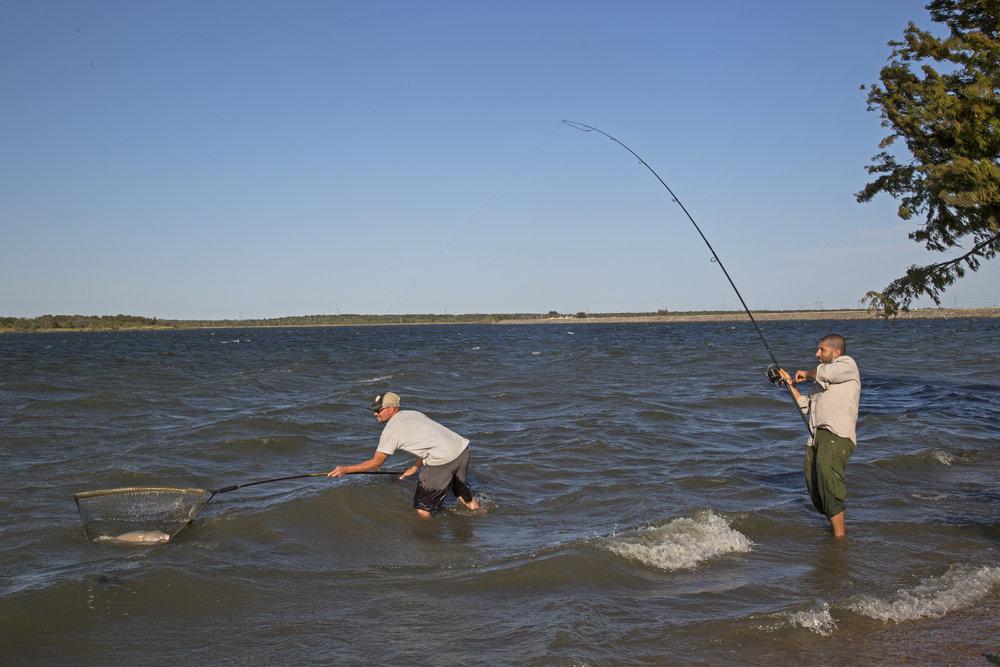 August netting carp for Ali in the waves.jpg