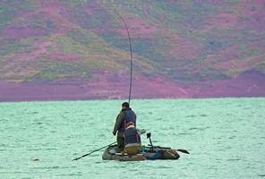 Ali fish coming to net in boat.jpg