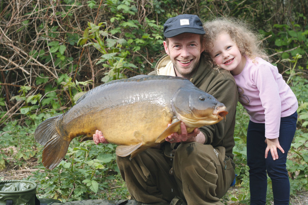 Dad and daughter time – a 37lb mirror called Trio from K1