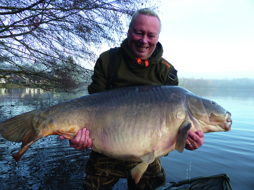 Keith Williams with an 81lb Lac Serreire mirror caught in the depths of winter from a regularly baited spot