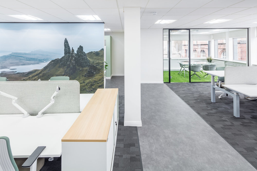 Double monitor arms mounted on-sit stand desks at the  new offices of CitNOW in Stirling
