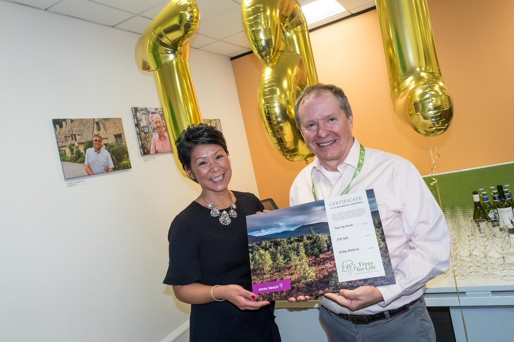 Paul Melhus, CEO and Founder of Tours By Locals, receives the tree certificate (28 trees) from  Kit-Har McLaughlin , interior designer @Amos_Beech, during a great office opening party in January 2019.