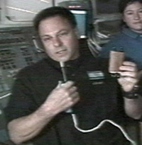 Col Ilan Ramon holds the Tiny Torah he carried into space.
