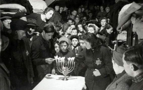 Chanukah, 1943, Westerbork, Holland. By a Jewish inmate, Rudolf Werner Breslauer, probably in early 1943. These people were later deported to death camps in Poland. From the Yad Vashem Photo Archive